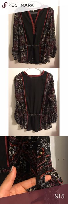Black Rainn long sleeve blouse Size large but I've been wearing as a tunic (I'm a small) and it still looks great! It has a drawstring waist and sleeves can be folded and buttoned up. Not free people, tagged for exposure. Free People Tops Blouses