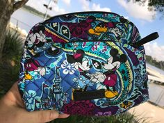 The new Disney x Vera Bradley Collection is now available at Disney Springs! The new Mickey's Paisley Celebration items have Disney Handbags, Disney Purse, Vera Bradley Disney, Vera Bradley Wallet, Backpack Purse, Purse Wallet, Prada Handbags, Fashion Handbags, Disney Luggage