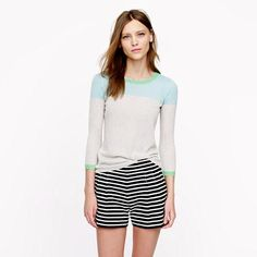 J.Crew Collection featherweight cashmere sweater in colorblock True to size.     Cashmere in a 14-gauge knit.     Hits at hip.     Three-quarter sleeves.     Rib trim at neck, cuffs and hem.     Hand wash.     Import. This three-quarter sleeve sweater is made of our featherweight cashmere, a tissue-soft knit that takes color especially well. Delicate and feminine, ours is made in a 14-gauge knit. (The higher the gauge, the finer the knit. This is about as fine as it gets.)