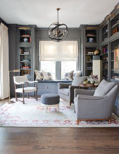 """""""The dark color really envelops you and feels cozy,"""" says interior designer Nina Nash. When she and her Mathews Furniture partner Don Easterling created this sultry and sophisticated study in Ansley Park, they installed classic built-ins, then furnished the room in rich tones from both ends of the color spectrum                                                                                                                                                                                 More"""