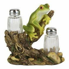 "Frog Salt and Pepper Shaker . $18.23. Frog Salt and Pepper Shaker. Can also be used with tea light candles (not included). Measures approximately 7"" tall. 2 glass shakers included. Comes gift boxed."