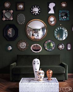 Andrea Ferrari View LargerView Thumbnails   A Living Room in Milan    The living room includes a group of limited-edition vases from Bitossi Ceramiche on top of a lacquered cocktail table. On the wall is a collection of mirrors, including vintage pieces by Barnaba Fornasetti's father, Piero.