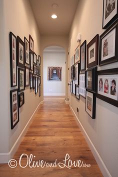 long hallway with family photo gallery