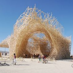 """Uchronia - Burning Man 2006: The Belgian artists who created this massive installation out of local pinewood for the 2006 Burning Man called it Uchronia. It took 50,000 pieces of 2 x 4 - a hundred miles worth - and a crew of nearly 100 paid employees to construct Uchronia on the Playa (Dessert), overseen by Belgians artist Arne Quinze and """"non-conventional entrepreneur"""" Jan Kriekels. Uchronia cost around $800,000 to build, and was ceremonially burned towards the end of the festival (like…"""