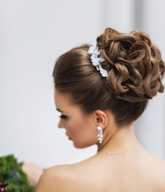 Beautiful princess-like wedding hairstyle with hair piece. via Elstile