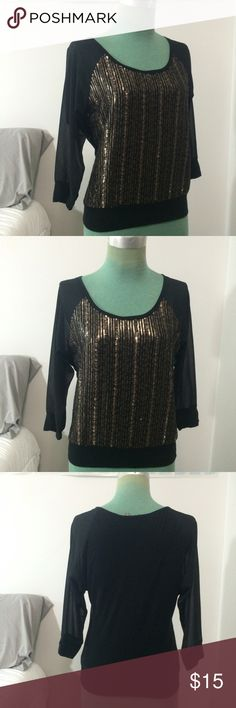 Express Black and Gold Blouse Perfect blouse/top for a night out. Brand is Express. Black (sheer on arms, opaque on the back and front) with gold sequins on the front. In great condition with no sequins missing. 3/4 length sleeves. Polyester and rayon. Tag says size xs, but would probably be really big on an extra small would better fit small. Express Tops Blouses