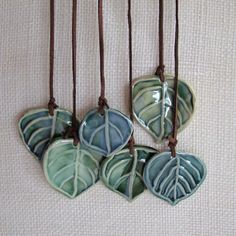 Items similar to Wall hanging, or Wind Chime, Ceramic Aspen Leaves on Etsy Ive a passion for trees. Leaves are the symbol for Immortality, as they will never die, wilt or turn brown! Each Aspen leaf has a word that I carved Ceramic Pendant, Ceramic Jewelry, Ceramic Beads, Ceramic Clay, Clay Beads, Polymer Clay Jewelry, Ceramic Pottery, Pottery Art, Pottery Studio