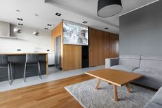 Open Apartment Uses Wood To Define Its Interior Spaces homedit.com