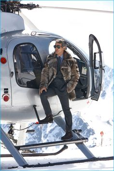 Andrew Lauren poses alongside a helicopter for Ralph Lauren Purple Label's fall-winter 2016 campaign.