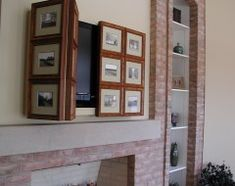 Houzz. Hide the TV. replace pictures with antiqued bevelled mirror panels, minimise size of frames.