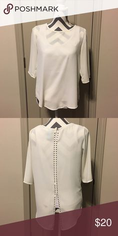 White Chiffon 3/4 sleeve top White chiffon 3/4 sleeve top with silver buttons down the back. Originally from Francesca's. Francesca's Collections Tops Blouses