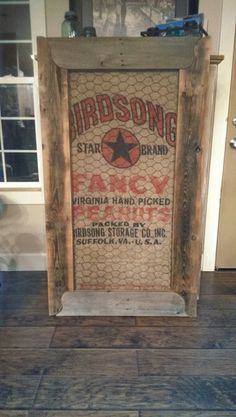 Love repurposed burlap feed bag, chicken wire and barn wood frame