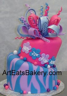 Pink, purple and blue fondant zebra and flowers girl's custom 16th birthday cake with sugar bow topper