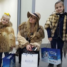 Very stylish mom and daughters in fur