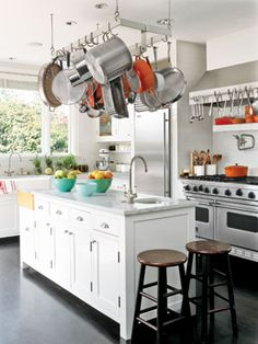 If you have the space, buy a rack to hang your pots and pans from the ceiling. Pot hangers are especially nice because they keep your pots and pans from getting scratched and they keep everything within arms reach. Smart Kitchen, Kitchen On A Budget, Diy Kitchen, Kitchen Decor, Kitchen Cabinets, Kitchen Ideas, Kitchen Country, Island Kitchen, Kitchen Small