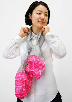 Origami-inspired scarves that transform into inflatable geometric forms, from Monomatopee