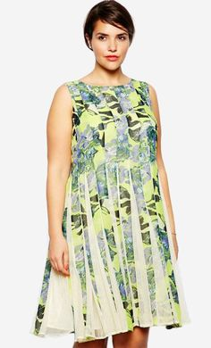 Made from a breathable woven fabric. Bright floral design with sheer mesh inserts. Round neckline. F...