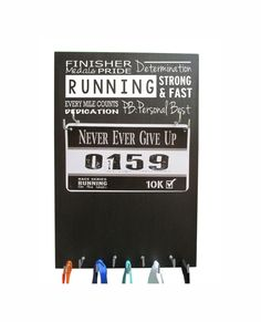 Gifts for runners  or Running gifts  for the by RUNNINGonthewall.com $27.99 LOVE this medal display holder rack hanger for runner. Best gift for all my marathon and half marathon race bibs and medals. The hooks van holder all my bling. sweet little runner gear. This really cool and awesome board frame shelf is sure to keep my running motivation high. This products is definitely on my bucket lists.