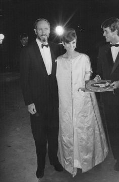 """The actress Audrey Hepburn photographed with her husband Mel Ferrer during their arrival at the Marigny Theatre for the Nuit du Cinema, when Audrey was awarded to the """"Victoire Award"""" (by Cinemondo) about her performance in """"My Fair Lady"""". Paris (France), October 29, 1965."""