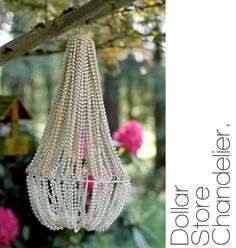 chandelier made from plant basket and stringed beads