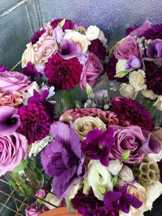Inside our cooler look at bridemaid's bouquets.  Shades of purple, blush pink, and neutrals. #studioag #studioagdesign