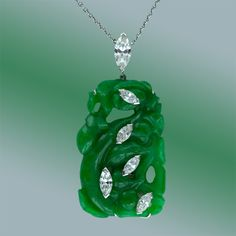 Fine Carved Jade and Diamond Pendant.    A gorgeous and unusual pendant necklace featuring a deep vibrant green jadeite carving studded with an array of bright white sparkling marquise-cut diamonds which apparently float over the jade. This illusion is achieved with expertly executed platinum wire work on the reverse. The pendant bail and clasp also feature fine marquise diamonds. A unique and wonderful gem!