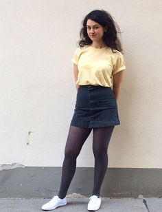 ★ ★ ★ ★ ★ five stars (pastel yellow tee sleeves cuffed, dark wash skirt, navy tights, all white sneakers)