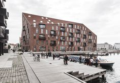 COBE and Vilhelm Lauritzen Architects complete warehouse-inspired housing for Copenhagen harbour