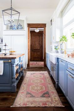 Blue lower cabinets