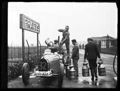 A photograph of a Bugatti racing car being fuelled, taken in September 1932 by Harold Tomlin for the Daily Herald. The Bugatti eight cylinder car was about to take part in a 500 mile race at Brooklands, Surrey. It was to be driven by Count Stanislas Czaykowski, the only foreign competitor. Czaykowski was a wealthy, Paris-based Polish aristocrat. He was killed the following year when his Bugatti crashed during a race at Monza, near Milan, Italy.