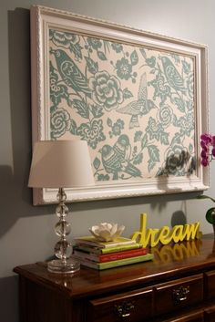Framed fabric – cheap fix to cover large empty wall -- want to do this over the corkboard for the office!
