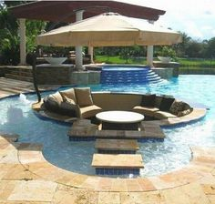 conversation pit surrounded by swimming pool...looks real cool, but the practicality of it wouldn't work.