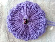 Frilly Quick Knit Flower is an adaptation to the Quick Knit Flower by Denice Johnson change by Dedi Boyer Knitted Flowers Free, Knitted Flower Pattern, Knitted Poppies, Baby Booties Knitting Pattern, Knitting Patterns Free, Crochet Flowers, Free Knitting, Baby Knitting, Crochet Patterns