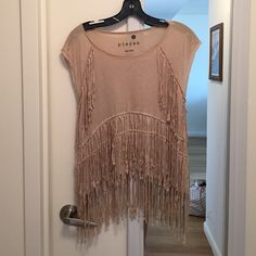 Kensie fringe crop top size medium Like new tan fringe crop top from Kensie size medium. looks really cute with jeans or shorts and boots. Very soft and comfy. Kensie Tops Crop Tops
