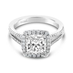 Ecali Presents: A claw set cushion shaped halo highlights the stunning 1ct centre diamond that sits atop an elegant split diamond band.