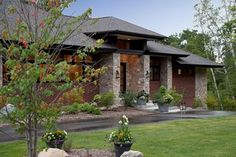 Prairie style facade with stone entry
