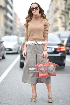 da6db607 A guest poses wearing Gucci shoes and a Fendi bag before the Etro show  during the