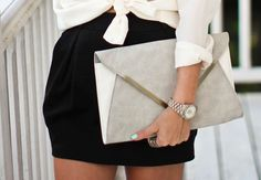 knot-tied top and large clutch