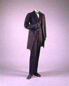 "Man's black wool suit, American, 1867-68. Label: ""Fiske & Beem, Ottawa, Ill."""