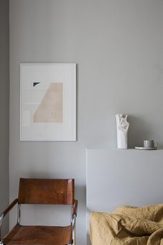 Grey bedroom with warm accent colors - via Coco Lapine Design blog