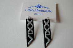 This listing is for a pair of 3D printed earrings inspired by VIXX.  The printed earring measures approximately 2.2 long plus the hook.  They are printed in black and white PLA filament on a Flashforge Creator Pro 3D printer. The file was designed by me in Sketchup.