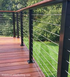 New deck in Woodsbury MN using customer-sourced wood with black aluminum posts and cable infill from Stainless Cable & Railing. Patio Railing, Cable Deck Railing, Aluminum Deck Railing, Handrails Outdoor, Railings For Decks, Deck Balustrade Ideas, Deck Railing Ideas Diy, Cable Fencing, Horizontal Deck Railing