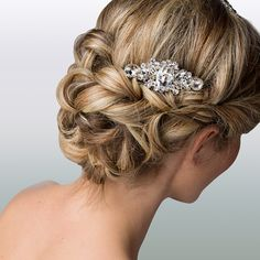Looking for a wedding hairstyle for your layered hair? Opt for a low bun done by twisting pieces of hair.
