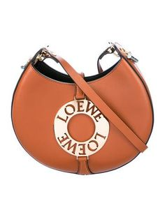 #LOEWE | Caramel leather Loewe Joyce crossbody bag with gold-tone hardware, single flat shoulder strap, black leather interior lining, single slit pocket at interior wall and magnetic snap closure at back. Includes dust bag. Shop Loewe designer bags online at The RealReal.