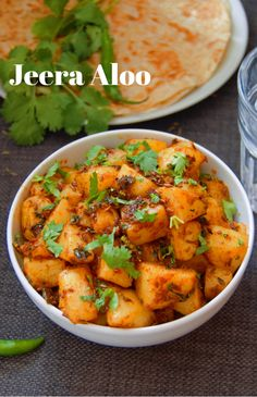 Jeera Aloo (Stir-fried Potatoes) Jeera aloo is a simple, easy, vegan and gluten free side dish that gets done in minutes and pairs well with chapathi, paratha. This Indian potato fry recipe is perfect for lunch box and a great party recipe. Aloo Recipes, Veg Recipes, Spicy Recipes, Curry Recipes, Dinner Recipes, Cooking Recipes, Recipes With Turmeric, Saffron Recipes, Paratha Recipes