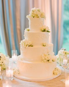 A+round+tiered+cake,+piped+in+butter+cream+and+adorned+with+white+flowers,+was+made+by+Perfect+Endings.+And+because+the+groom+loves+milk+with+his+sweets,+shot+glasses+full+of+the+childhood+staple+was+served+with+each+piece.