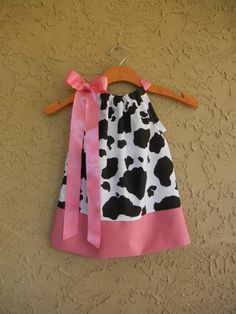 Pink Cow Print Pillowcase Dress  sizes 6m to 5TSO by theuptownbaby, $25.00... Just ordered two of these for the girls' dual birthday party (barnyard) themed.. except Alesca's will have red fabric on the bottom and a red ribbon, rather than pink. Super cute.