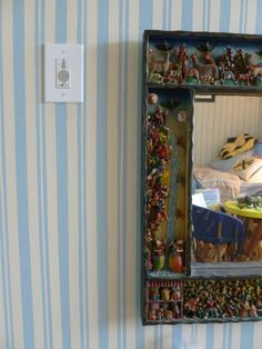 In my eldest's room I laboriously taped and painted mattress ticking stripes, and it turned out beautifully. (I'd fallen in love with Hollywood at Home's trop cher fabric version.) Retablo mirror from Peru; in mirror you can see his wee equipales which I had made in San Miguel de Allende -- darling!