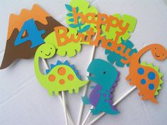 Dinosaur Birthday Party Toppers/Centerpieces-Set of 5 by JudeBugsBabySweets on Etsy https://www.etsy.com/listing/155737213/dinosaur-birthday-party
