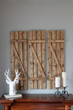 How to create DIY Barn Wood Shutters......I love these, I can see a beautiful home made wreath hanging on the center one :)